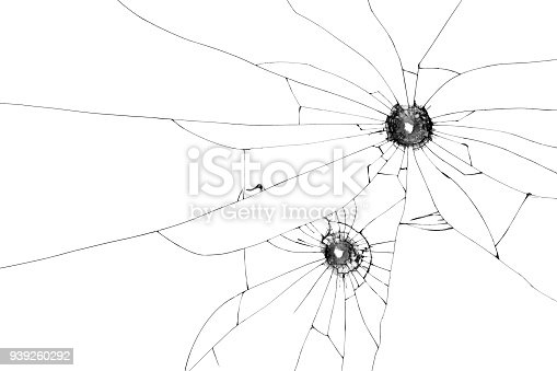 istock Two bullet holes on window isolated on white background. Cut out. 939260292