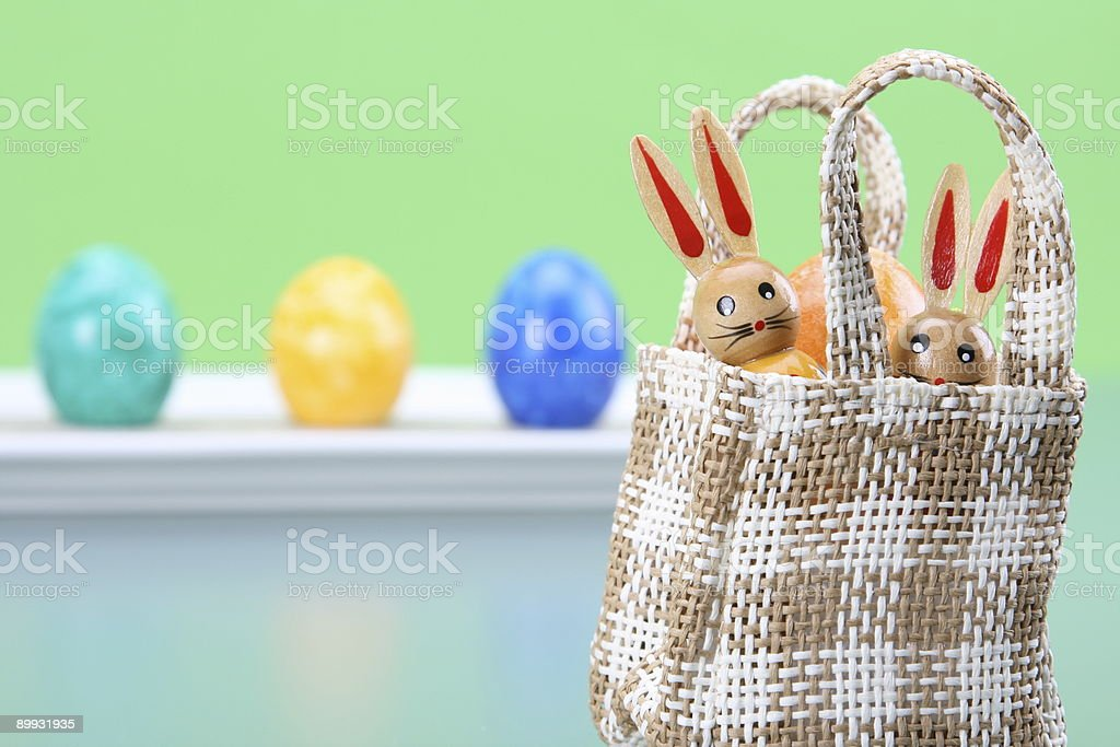 Two Bunnies in Bag with Eggs royalty-free stock photo