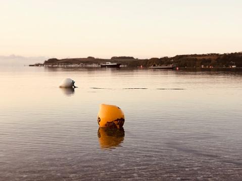 Two buoys at Loe Beach