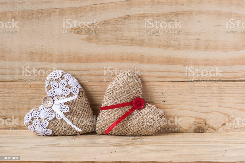 Two burlap hearts on woody background stock photo more pictures