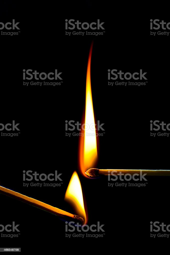 Two burning matches royalty-free stock photo