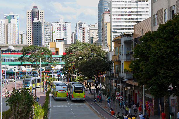 Two Buses in Belo Horizonte with buildings on the background stock photo