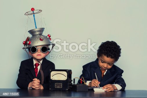 istock Two Business Boys Maximize Ideas with Mind Helmet 486115005