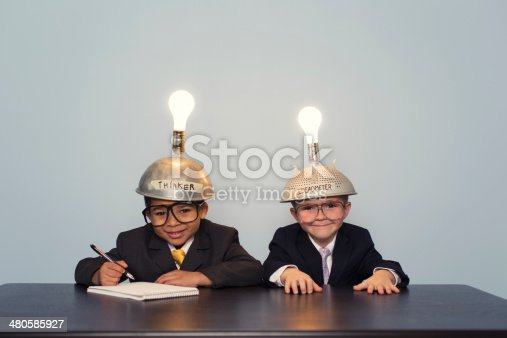 480585411 istock photo Two Business Boys Wearing Lit Up Thinking Caps 480585927
