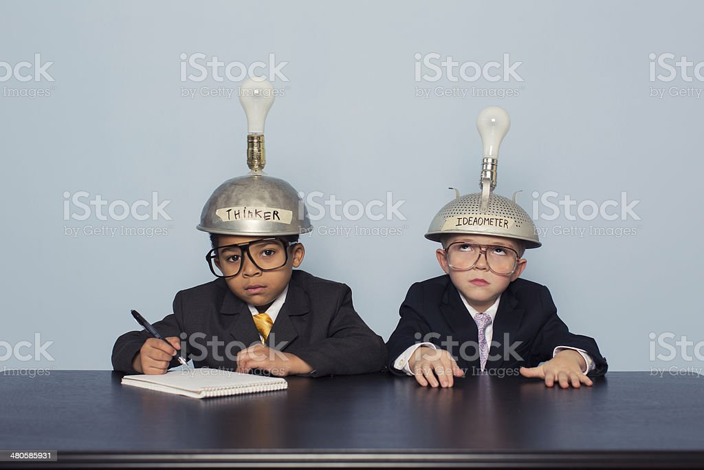 Two Business Boys Wearing Thinking Caps are Confused stock photo