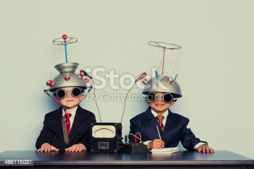 istock Two Business Boys with Mind Reading Helmets 486115031