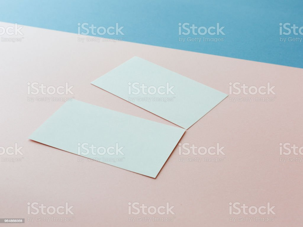 Two business cards on multicolored background royalty-free stock photo