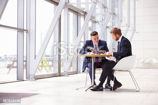 istock Two business colleagues at meeting in modern office interior 487810176