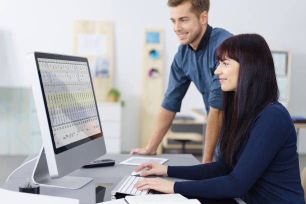 Two business colleagues checking a spreadsheet stock photo