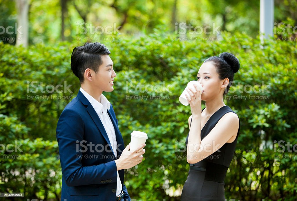 Two asian young adults in luxurious business class clothing are...
