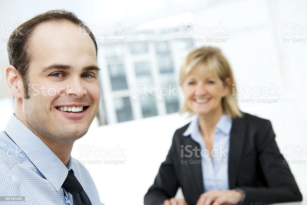 Two Business Colleagues.  Male & Female royalty-free stock photo