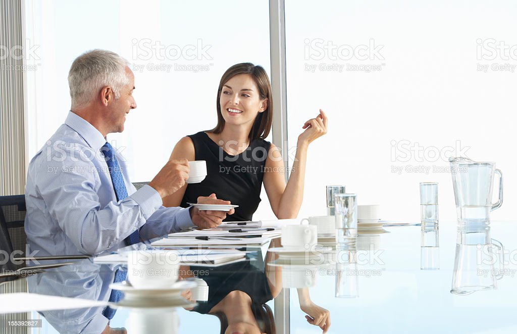 Two Business Colleagues Sitting Around Boardroom Table royalty-free stock photo