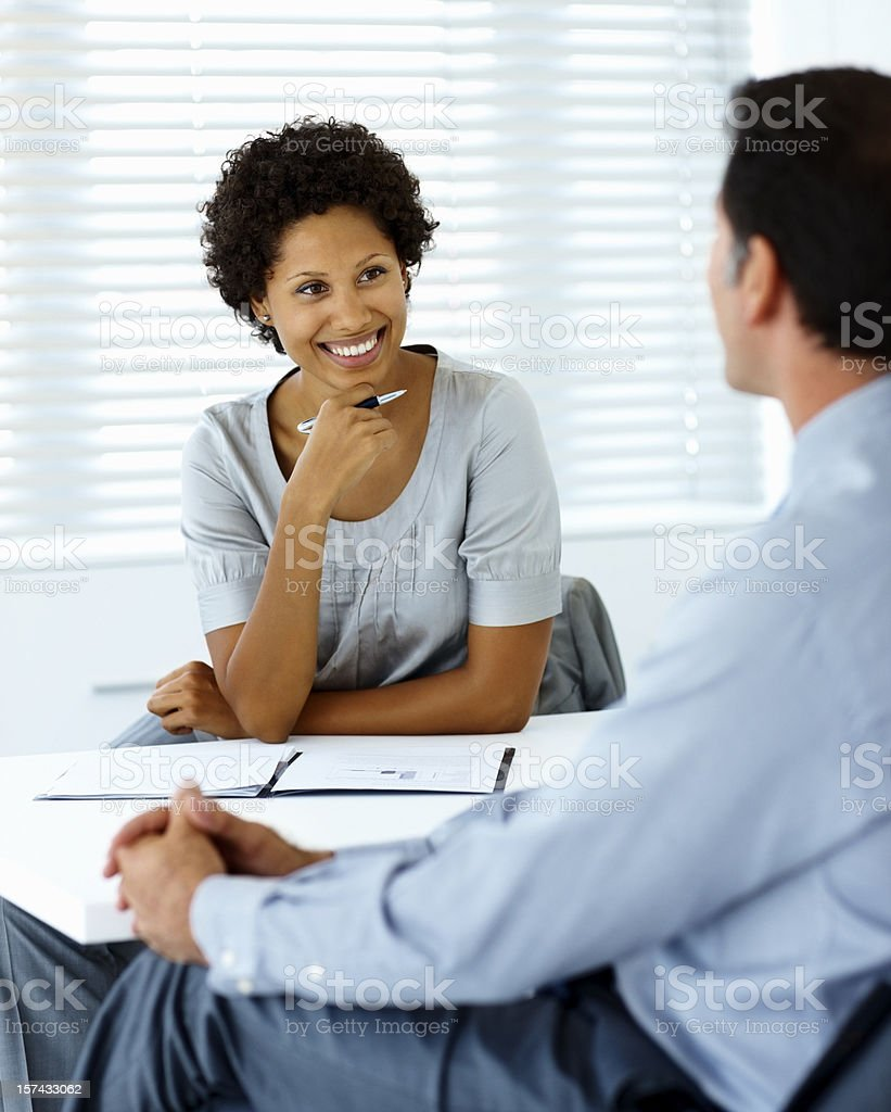 Two business colleagues smiling during a meeting royalty-free stock photo