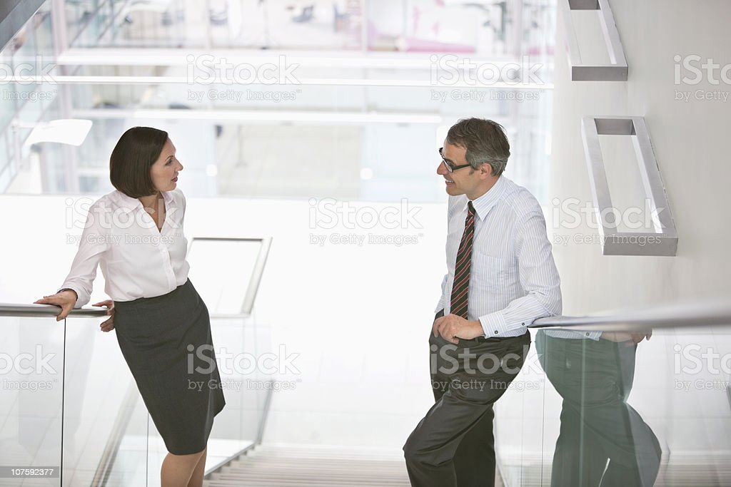 Two business colleagues talking on staircase in office royalty-free stock photo