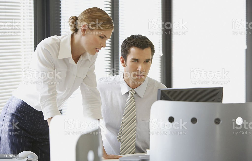 Two business colleagues talking stock photo