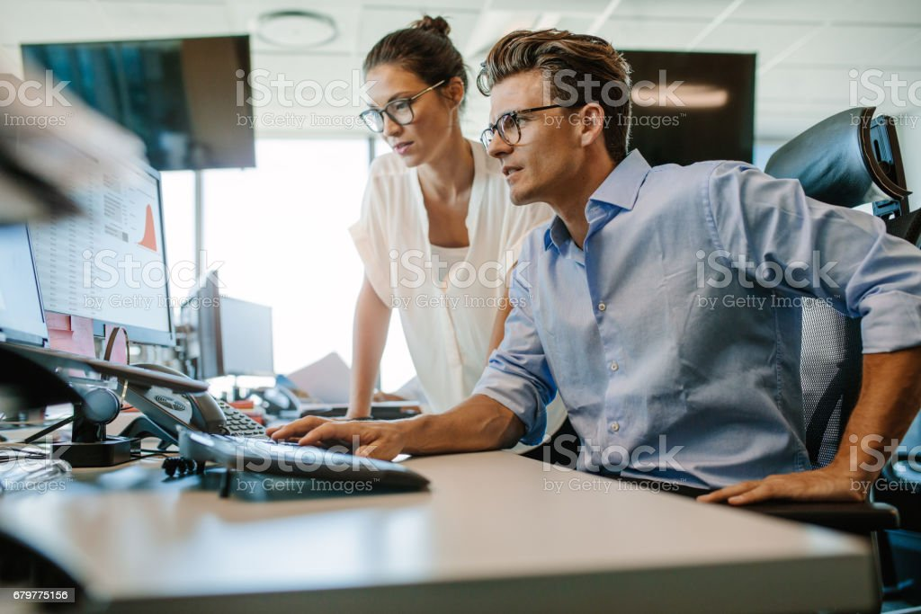 Two business colleagues working in their office stock photo