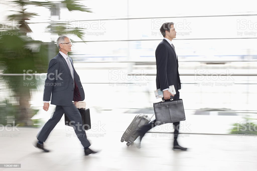 Two business executives with luggage, side view royalty-free stock photo