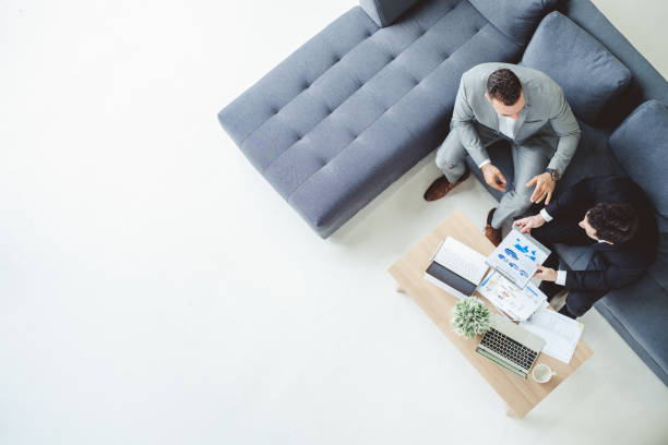 two business man discussing work on table in office, top view - business meeting imagens e fotografias de stock