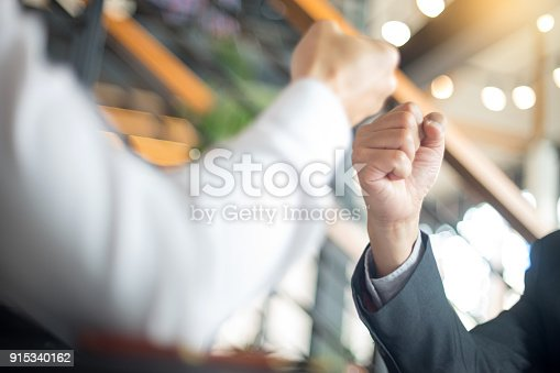 istock two business man use hand to fist bump 915340162