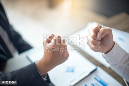 istock two business man use hand to fist bump 915340264
