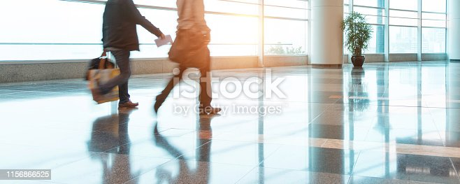 istock Two business man walking through a modern architecture hall 1156866525