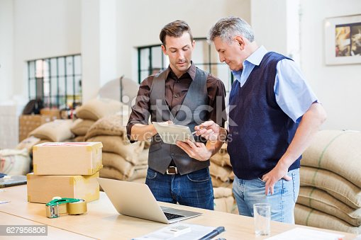 istock Two business men at coffee storage room 627956806