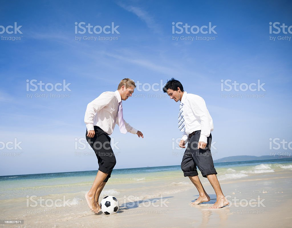 Two business men on beach royalty-free stock photo