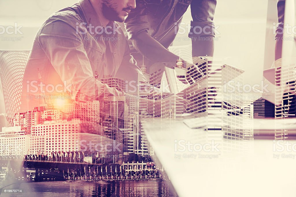 Two Business men working on digital tablet. stock photo