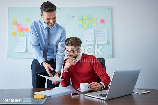 istock Two business partners reading contract document at office 1032551842