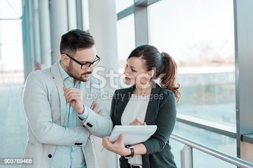 istock Two business people discussing about work. 903769468