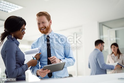 istock Two business people discussing market research data in office 906092300