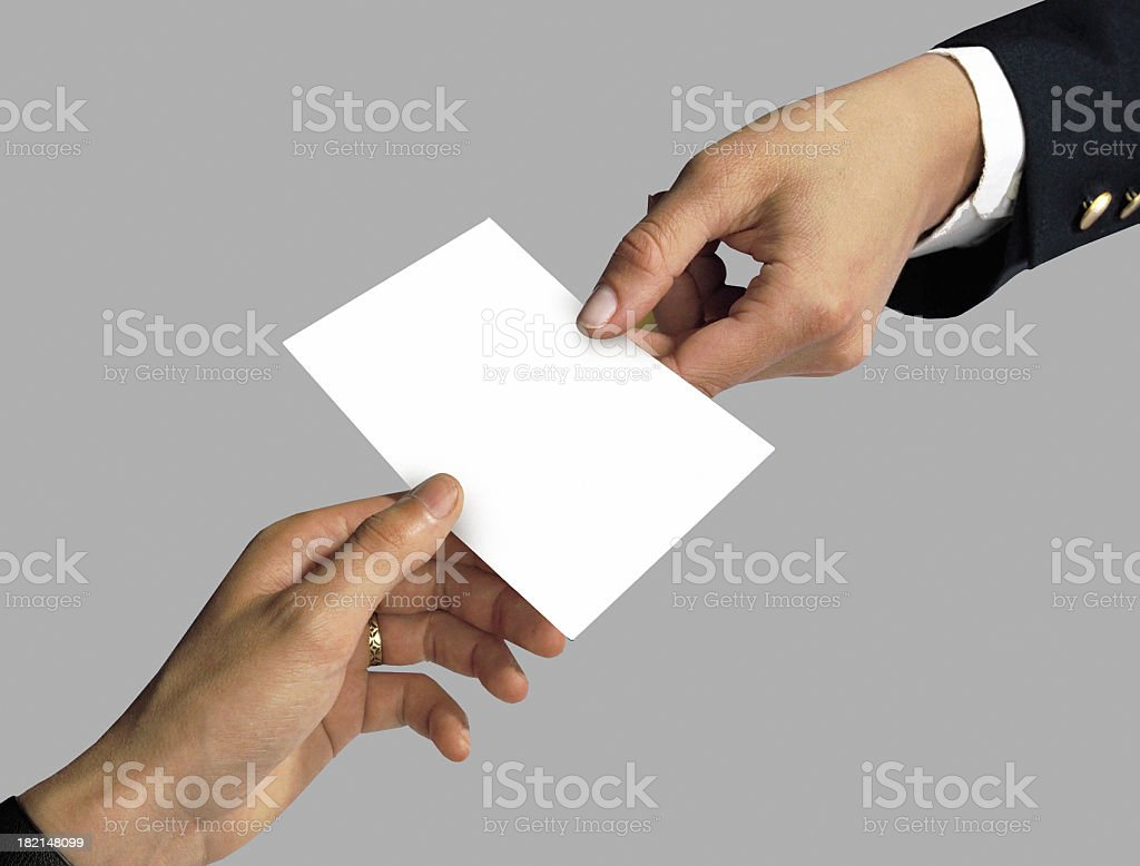 Two business people handing exchanging a blank paper royalty-free stock photo