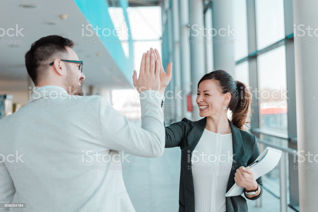 Two business people high-five. Job well done. - foto stock