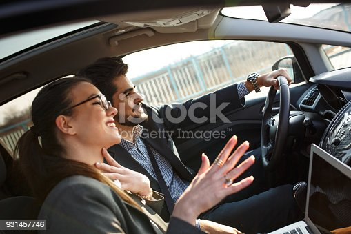 istock Two business people in the car. 931457746