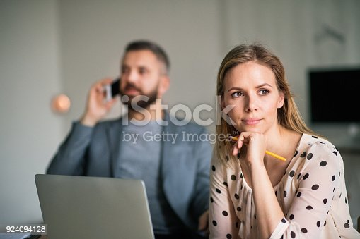 913346608 istock photo Two business people in the office. 924094128