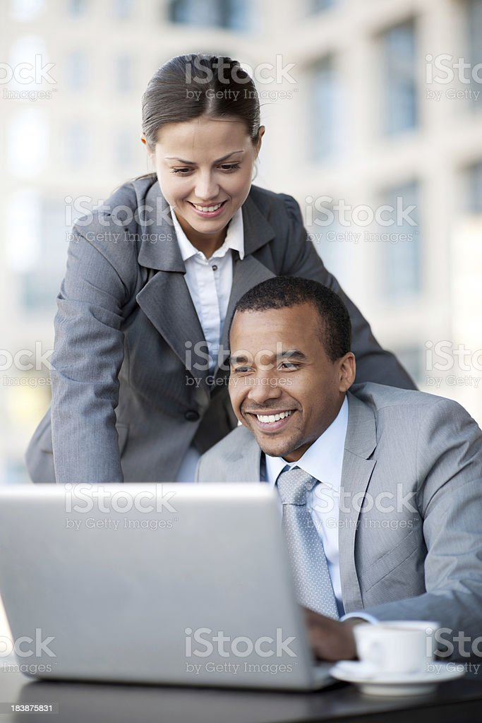 Two business people looking at the laptop. royalty-free stock photo
