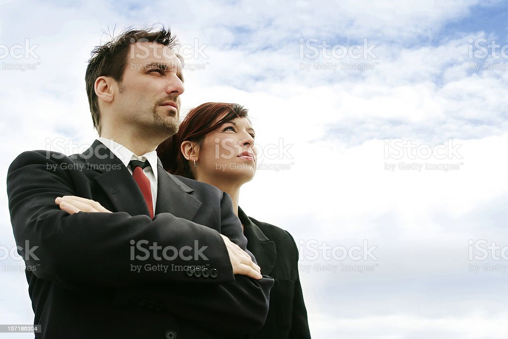 Two business people looking away. royalty-free stock photo