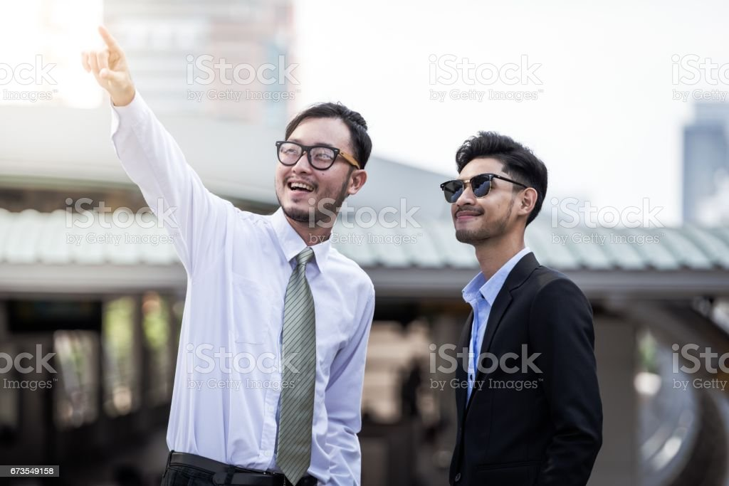 two business people looking up show and point upper royalty-free stock photo