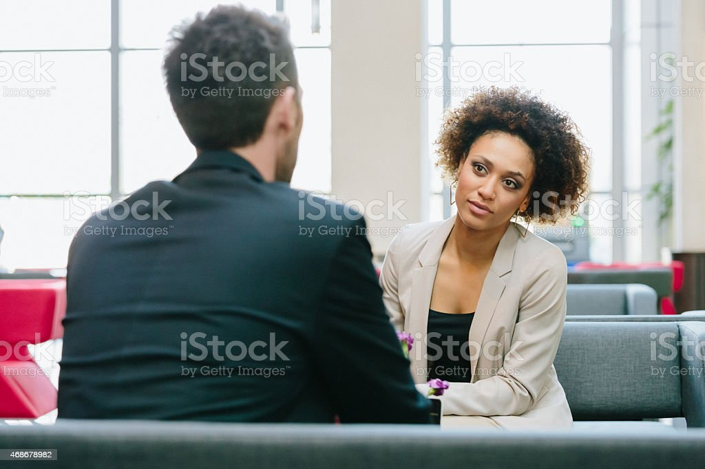 Two business people meeting in a bar stock photo