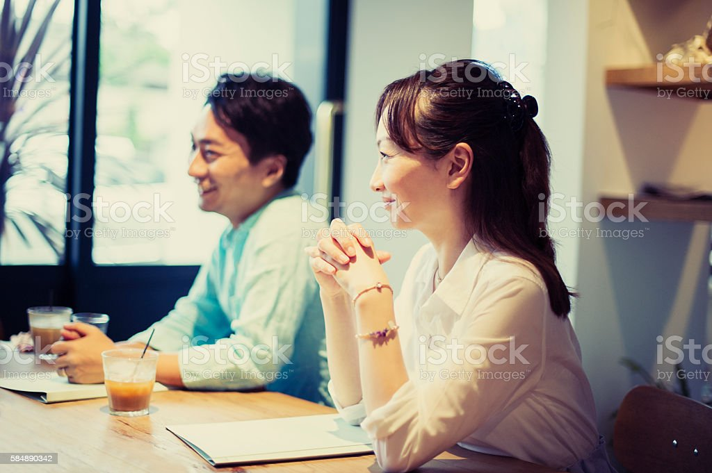 Two business people meeting in a cafe stock photo