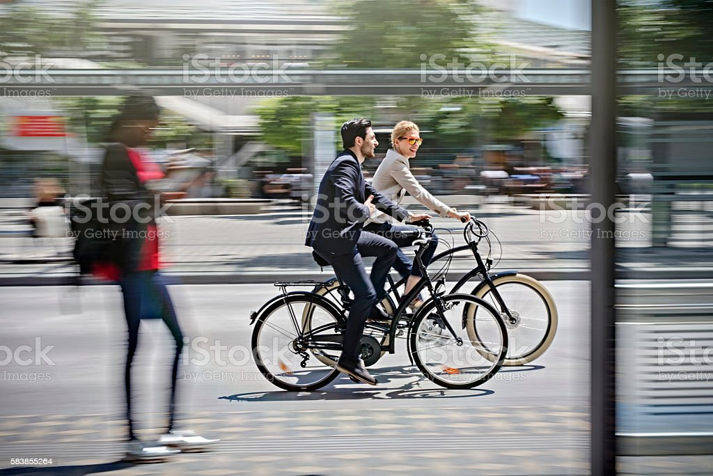 two business people riding bicycle – Foto