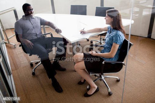 496441730 istock photo Two business people sitting at a conference table 462011015