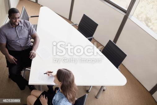 496441730 istock photo Two business people sitting at a conference table 462535889