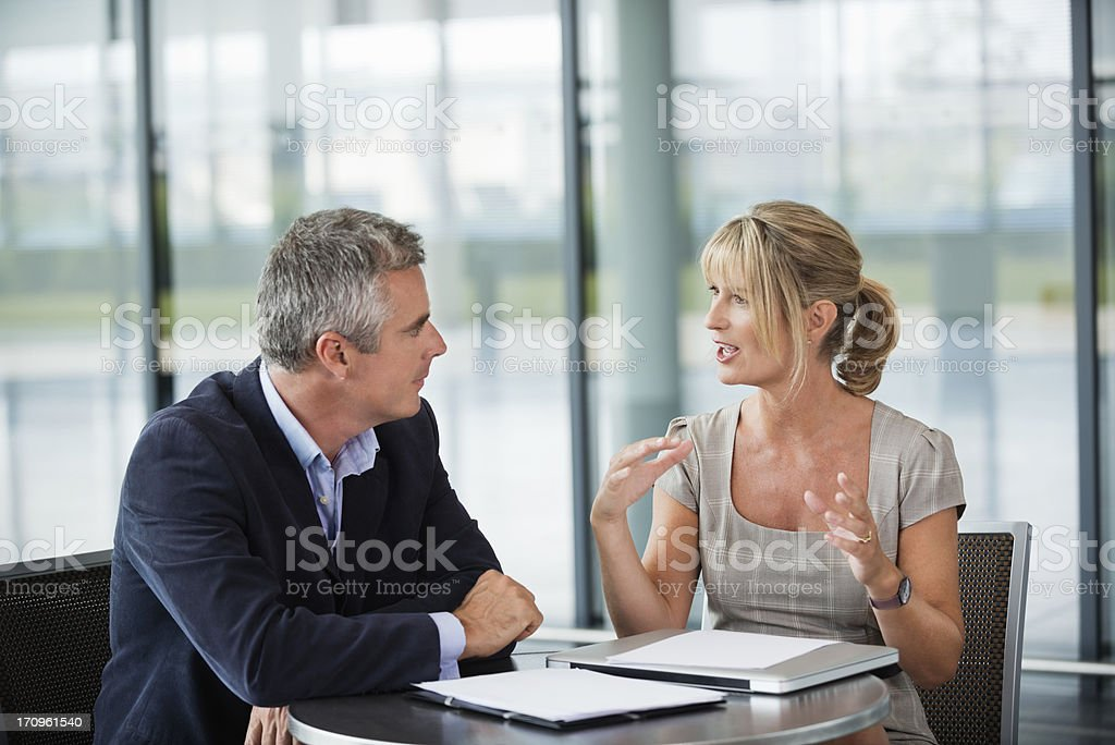 Two business people sitting, having a conversation stock photo