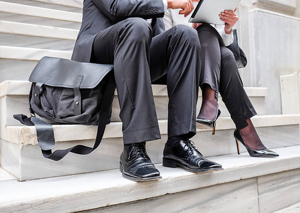 two business people sitting on steps. stock photo