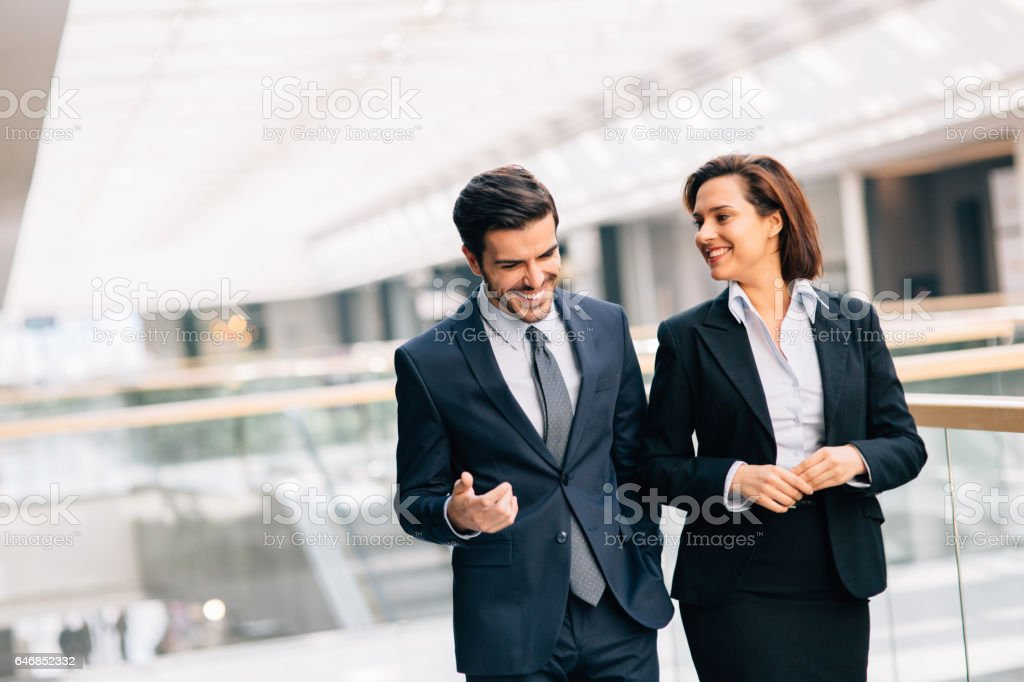 Two business people taking a break at work stock photo