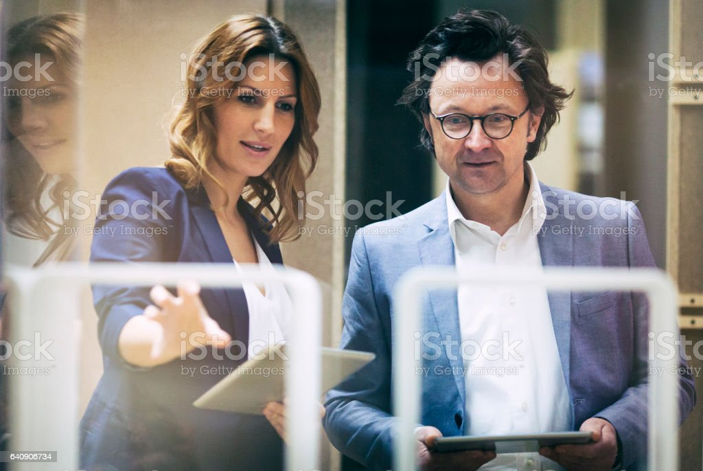 Two business people talking in the in the showroom stock photo