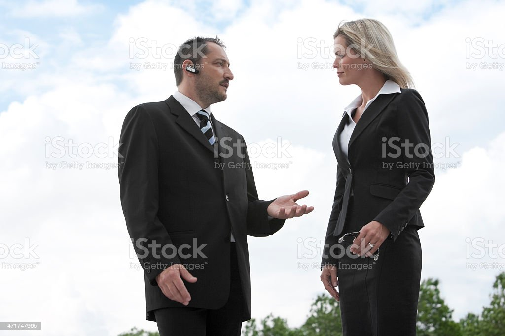 Two Business People Talking Outside royalty-free stock photo
