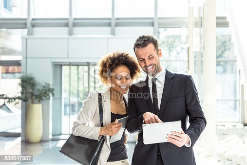 istock Two business people using a digital tablet in an office 538647937