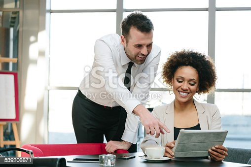 istock Two business people using a digital tablet in an office 539206671